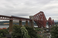 68007 Valiant crossing the Forth bridge (Andrew Edkins) Tags: forthbridge firthoffife 68007 valiant class68 type5 cat stormtrooper geotagged canon railwayphotography northqueensferry scotland fife locohauled autumn light afternoon passenger commuter fifecircle 2017 september travel trip diesel scotrail trees bridge overcast clouds red blue uk