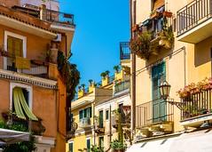 Taormina Sicily (Daveyal_photostream) Tags: nikon nikor meandmygear mygearandme mycamerabag porches flowers veranda d600 buildings vase bluesky