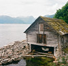 Hytte (amelia.seddon) Tags: fjord sognogfjordane water cabin hytte film fishing rolleiflex mediumformat kodak ektar 120film squareformat norway scandinavia europe leikanger decay moss abandoned solitary wood log boat lake mountains seaweed