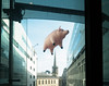 Pig-Seen-Through-a-Window (stevedexteruk) Tags: pig inflatable balloon pinkfloyd animals algie nbh broadcastinghouse window floating flying allsouls church langham