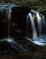 Splashes of Light (lancekingphoto) Tags: frozenheadstatepark debordfalls waterfall tennessee morgancounty nature hiking sunlightonwater fallcolors autumn stream minoltaxgm minoltamd50mmf17 35mm film velvia50 expiredfilm unicolor transparency slidefilm