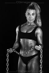 Fitness - Chains (CGiMagery) Tags: fitness bikini elinchrom speedlight nikon sb900 rx600 d500 tamron muscle flex babe abs lowkey cgimagery blackandwhite bw portrait chains ponytail