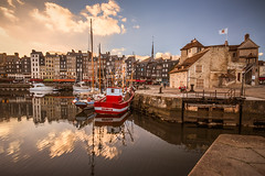 "colourful boats in the Vieux Bassin (Old Harbour) on an autumn evening, Honfleur, Calvados, Normandy, France (grumpybaldprof) Tags: honfleur normandy normandie france calvados fineart ""fineart"" impressionist impressionistic ethereal artistic evening autumn sunset ""vieuxbassin"" ""oldharbour"" ""quaistecatherine"" ""quaiquarantaine"" quai ""quaistetienne"" ""stecatherine"" ""lalieutenance"" quarantaine water boats sails ships harbour historic old ancient monument picturesque restaurants bars town port colour lights reflection architecture buildings mooring sailing stone collombage halftimbered yachts carousel merrygoround reflections ""waterreflections ""wetreflections""funfair ""eglisesaitecatherine"" yacht voillier canon 70d ""canon70d"" sigma 1020 1020mm f456 ""sigma1020mmf456dchsm"" ""wideangle"" ultrawide"