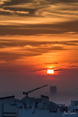 Sunrise construction (Jerzy Orzechowski) Tags: dubai sky silhouette sunrise buildings constructioncranes uae