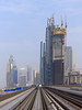 Towers on the Right Side (Kombizz) Tags: 1130477 kombizz dubai middleeast persiangulf khalijfars khaleejfars 2015 unitedarabemirates uae architecture building citypremierehotel vanishingpoint metrotraintracks traintracks towers burj buildings manazelalsafatower towersontherightside