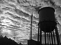 ( All along the water tower ) (Wandering Dom) Tags: clouds watertower urban people architecture earth being nothingness time life reality dreams roam wandering multiverse nuages