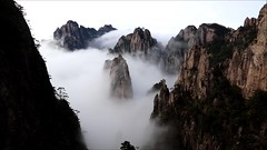 Sea of Clouds - HuangShan (8x) (lycheng99) Tags: seaofclouds huangshan clouds mountains peaks trees pines islandsofpeaks anhui china travel nature landscape wonders movement cloudmovement motion