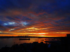 October ended like a conflagration (+2) (peggyhr) Tags: peggyhr sunset clouds sky harbour skyline silhouettes cityscape freighter autumn dsc00157ab vancouver bc canada blue red black reflections series