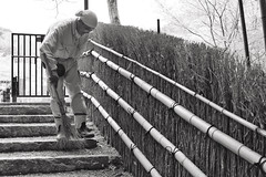Adashino Nenbutsuji X (Douguerreotype) Tags: broom clean sweep temple monochrome candid people blackandwhite street kyoto mono cemetery stairs graveyard bamboo japan shrine bw steps