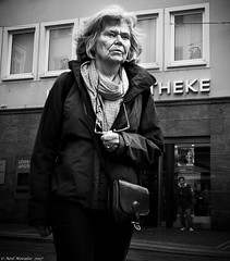 Aches and Pains (Neil. Moralee) Tags: neilmoralee neilmoraleenikond7200 woman lady female old mature street candid ache pain crossing scarf black white bw bandw mono monochrome blackandwhite gray greyscale building people germany freiberg hair face portrait alone elderly age ageing older handbag shoulder bag dark neil moralee nikon d7200 arthrisis burden painful walk walking low point view pov lpov fitness