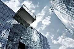 cube & reflect (christikren) Tags: modern austria architecture building christikren facade perspective clouds fenster fassade glas sky spiegelung linescurves light lines mirror offices panasonic reflection vienna windows skyscraper