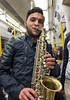 Busker on London tube (chrisjohnbeckett) Tags: saxophone busker busking portrait music instrument woodwind london londonist timeout tube underground train people chrisbeckett fujifilmx100f