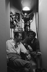 Rex Harrison, Roddy McDowall 1 (cinenegro50) Tags: specialratephotographer restricteduseusaonly blackandwhite behindthescenes smiling grinning laughing talking looking profile profileshot glasses sweater buttondown unbuttoned shirt crossedlegs crosslegged sitting leaning leaningback leanedback resting stairs camera light lights plant mirror cigarette smoking wristwatch chair