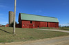 John Ball Barn — Fayette Township, Hillsdale County, Michigan (Pythaglio) Tags: john ball barn building structure historic agriculture fayette township hillsdale county gambrel roof metal standing seam silo red painted vertical boards wood doors driveway dirt road gravel unpaved utility pole sky blue clouds