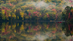 Franconia Notch, New Hampshire, USA (christopherhawkinsimages.com) Tags: pond lake reflection fall autumn leaves maple forest pine canoe canoeing