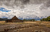 Old Barn (Rick Derevan) Tags: jacksonhole wyoming snow grandtetons mountains peaks barn mormonrow homestead clouds