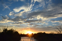 Sun Heading South (NaturalLight) Tags: sunset chisholmcreekpark wichita kansas clouds