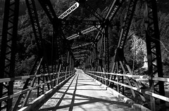 Bridge of shadows. (draskd) Tags: bridge ramganga ramgangariver metalbridge uttarakhand blackandwhite kumaontravel jimcorbett maneatersofkumaon landscape tigercountry shadows angles linesandangles rivet sun overhead contrast