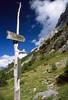 This way up... (Benedict Todd) Tags: path olympus om4 berneseoberland precisact switzerland holiday mountains summer 2017 alps schweiz e6 ostegghut agfa transparency sky polariser sign polarizer slide berneroberland
