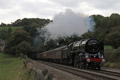 70013 bursts out of Milford tunnel (Andrew Edkins) Tags: 70013 olivercromwell britanniaclass pacific milfordtunnel peakforester railtour charter porthole brit belper milford thechevin trees railwayphotography light autumn 2017 october geotagged canon travel trip sky derbyshire england uksteam