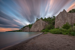 Sunset at the Bluffs III (B.E.K.) Tags: sunset scarborough bluffs toronto ontario canada outdoor landscape longexposure clouds sky water lake shore coast sand rock formation trees