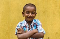 Outdoor portrait of a cute little indian boy (Nithi clicks) Tags: boy yellow indian village kid india child happy street kerala people portrait poverty ethnic fishing asia asian attractive cheerful childhood face happiness kovalam little outdoor person smile traditional travel unidentified young