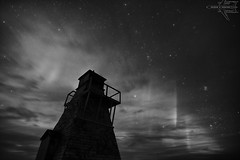 Gull Harbor Lighthouse (B&W) (Winglet Photography) Tags: wingletphotography northernlights auroraborealis georgewidener stockphoto solar storm aurora geomagnetic earth sun canon 7d georgerwidener night nighttime longexposure dark inspiration lights colors sky lighthouse hecla manitoba island gullharbour old canada heclaisland 1898 pleiades hyades galaxy milkyway monochrome blackwhite artsy