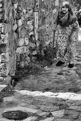 In A Brick World (Alfred Grupstra) Tags: blackandwhite people old history cultures oldfashioned women retrostyled outdoors obsolete antique men senioradult conceptsandideas females oneperson victorianstyle monochrome agingprocess ulcinj montenegro