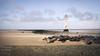 Perch Rock Lighthouse2 (Snipsnapper. Back after a long absence, long story) Tags: perchrocklighthouse seascape dog sand rock rocks seagull sanddrift