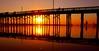 Under The Boadwalk.... (law_keven) Tags: usa america newportbeach photography sunset sun red orange travel roadtrip pier newportpier ocean pacific pacificocean silhouetts