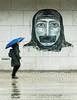 No Voice (Rachel Dunsdon) Tags: norway wall woman novoice brolly raining wet graffiti art gagged gag