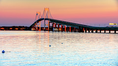 Pell Bridge at Dawn (Ian Charleton) Tags: pellbridge sunrise newportbridge newport rhodeisland narragansettbay relfection water sky spectrum dawn sunset morning architecture polarizingfliter cpf