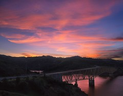 Over Lake Sonoma (RZ68) Tags: sunset sunrise color clouds lake sonoma county california water reflection pink orange sun light bridge yellow vista rz67 velvia provia e100 wide angle big sky high