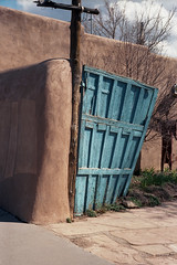 Blue door curve (ADMurr) Tags: nm taos blue wood orange adobe bare trees m4 40mm lens kodak ektar cbb243 door gate pole leica hinge 2016