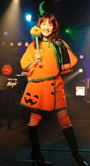 On Halloween, We Must Be (emotiroi auranaut) Tags: woman lady halloween singer stage costume pretty attractive club music musical holiday fun beauty beautiful charm charming orange green