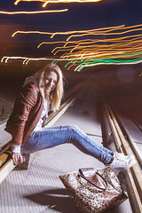 Positive Caucasian Woman In Leather Jacket and Blue Jeans Playing on Rails With Bag Outdoors at Night.Listening To Music player. Halogen and Flash Lights are Used. (DmitryMorgan) Tags: 1 2027years 20s activity adult beautiful blond blondy casual caucasian city emotions enjoying expressive feelings female feminine flashlight girl guitar halogen happiness havingfun leatherjacket musician nightshot one outdoors outside performing playing rails red romantic sensual sensuality singing smiling springtime streetlife talented twenties woman young