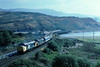 We start the oldies 2nite in Mid Wales, with Saturday dated holiday trains which provied useful employment for pairs of tractors in the summer....37431/181 0730 Euston-Phewelli pulls off the viaduct at Pendryneudraeth 20-09-1986 (the.chair) Tags: 58028 fiddlers ferry psdaw mill cranberry staffs aug 1998 37431181 london euston phwhelli pendredrydrauth sept 1986