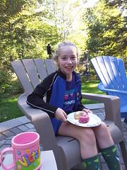 Granddaughter Tori Enjoys Doughnuts (steveartist) Tags: girls children tori chairs trees sunlight smilinggirls grandkids doughnuts cups galaxytabs2camera aviary pixlr backyards portraits