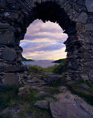 Strome Castle at Sunset (Benjamin Driver) Tags: ektar pentax6x7 strome castle colour loch lochcarron carron clouds purple magenta frame 120 mediumformat medium format film kodak scotland highlands