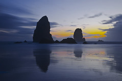 Examiners of Night (El Justy) Tags: scenic pretty beautiful nightphotography night theneedles seastacks cannonbeach haystackrock oregon oregoncoast pacificnorthwest westcoast clatsopcounty pacificocean pacificcoast pnw usa landscape seascape sunset silhouettes sky clouds sun water ocean sea waves rocks light shadows outdoors beach sand reflections travel travelphotography photo photography beauty calm peaceful justinrice longexposure cool wind breeze rock outdoor color colors nature scenery wildlife birds shadow world earth planet autumn october fall unitedstates