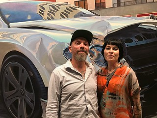 Artist Tim Bulwalda and Charity Von Guinness with Tim's artwork at LnS Gallery's grand opening
