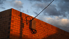 Glowing Bricks (Theen ...) Tags: blue box brick cable electric electrical etsa last light lumix red shadow sky sunset theen underdale wall