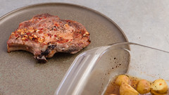 Baked marinated pork cutlet with potatoes. (annick vanderschelden) Tags: raw pork cutlet marinating ingredients grounded blackpepper seasalt choppedgarlic sugarcanesugar soysauce lemonjuice sunfloweroil redwinevinegar sambal worcestershiresauce baked smallpotatoes herbesdeprovence whitekitchenboard pointofview meat marinade marination pig salt chopped sugarcane soy sauce vinegar potato belgium