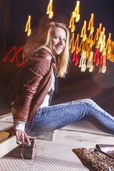 Happy Caucasian Woman In Leather Jacket and Blue Jeans Playing on Rails With Bag Outdoors at Night.Listening To Music player. Halogen and Flash Lights are Used. (DmitryMorgan) Tags: 1 2027years 20s activity adult beautiful blond blondy casual caucasian city emotions enjoying expressive feelings female feminine flashlight girl guitar halogen happiness havingfun leatherjacket musician nightshot one outdoors outside performing playing rails red romantic sensual sensuality singing smiling springtime streetlife talented twenties woman young