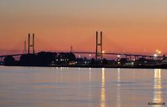 City To City (Clayton Perry Photoworks) Tags: vancouver bc canada fall autumn explorebc explorecanada newwestminster bridge sunset alexfraserbridge fraserriver reflections