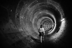 underground (petdek) Tags: tunnel monochrome highcontrast blackandwhite underground walkingpeople shadowplay urban geometry vanishingpoint