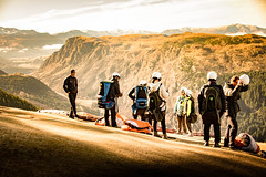 Waiting for a fly (amcatena) Tags: sunset people tree new zealand mountain cloud helmet slky paraglidding