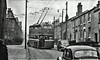 Huddersfield Trolleybus on Route 72. (ManOfYorkshire) Tags: huddersfield route72 hills hilly trolleybus bus 6wheel 1960s bw scan photograph blackwhite nostalgia history morris minor morrisminor van pvh932 632 6wheeler triaxle sunbeam corporation