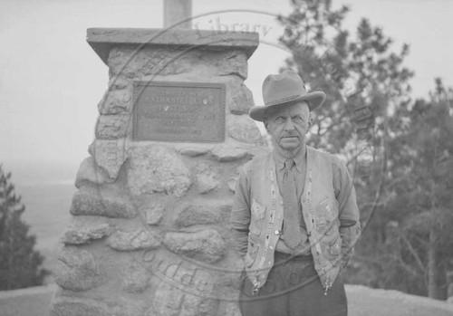 Photo - Ranger Martin Parsons at the Flagstaff Mountain flagpole (1937).