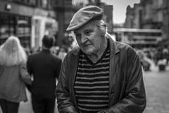 Saggy Old Cloth Cap (Leanne Boulton) Tags: portrait people urban street candid portraiture streetphotography candidstreetphotography candidportrait streetportrait streetlife old elderly man male face facial expression eyes look emotion feeling mood cap atmosphere sad sadness misery lonely loneliness tone texture detail depthoffield bokeh naturallight outdoor light shade shadow city scene human life living humanity society culture canon canon5d 5dmkiii 70mm character ef2470mmf28liiusm black white blackwhite bw mono blackandwhite monochrome glasgow scotland uk